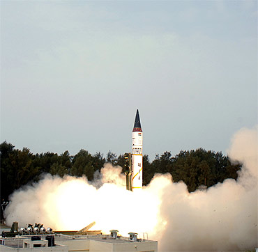 A file photo of nuclear-capable Agni missile taking off