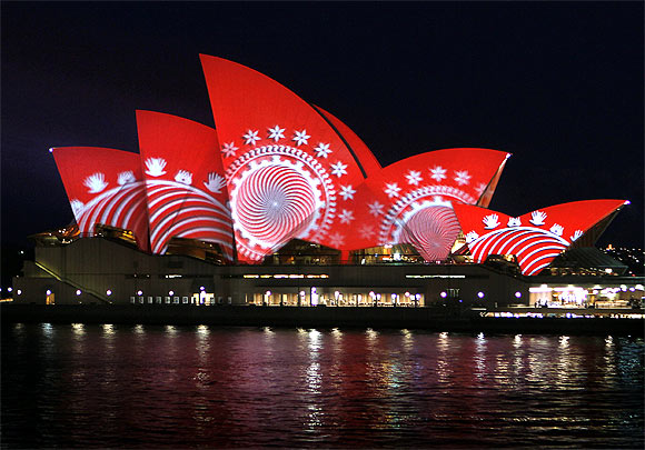 The sails of the Sydney Opera House turn red during a World Aids Day reception in Sydney