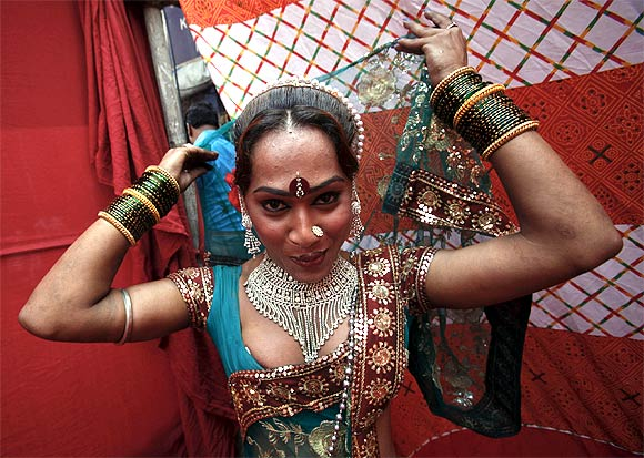 Raksha, 25, a sex worker, prepares for a performance in Mumbai's Kamathipura red light district