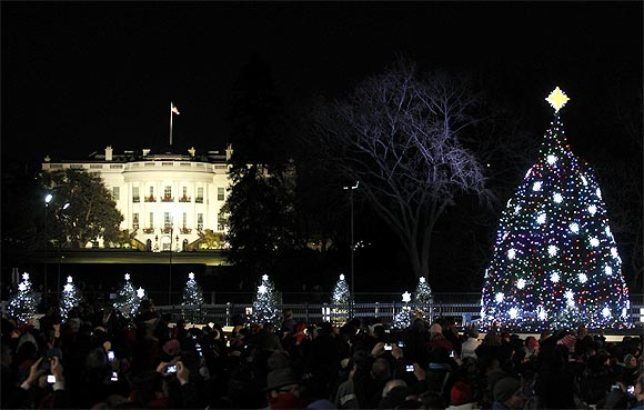 The National Christmas Tree is lit in front of the White House during its lighting ceremony in Washington