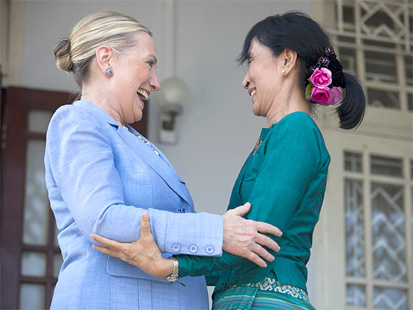Suu Kyi and Clinton embrace after their meeting at Suu Kyi's residence laying out a framework for reforms