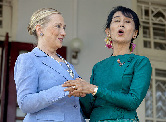 Clinton and Suu Kyi share a joke after their talks on Friday