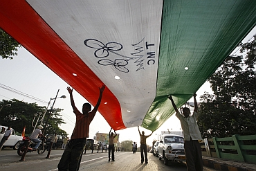Supporters of the Trinamool Congress party carry the party's flag