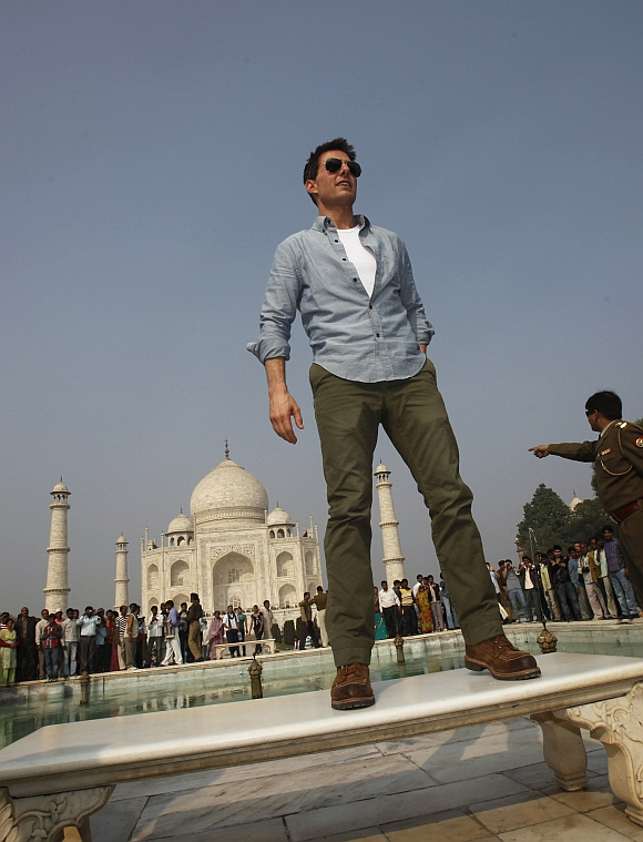 Actor Tom Cruise poses for photographers at the historic Taj Mahal in Agra