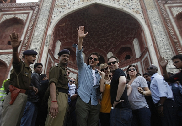 Cruise waves towards his fans as he arrives at the Taj Mahal