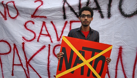 A student holds a placard during an anti-American demonstration near the U.S. consulate in Karachi