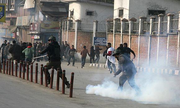 Kashmiri youth clashed with security forces during a Muharram procession in Srinagar on Sunday