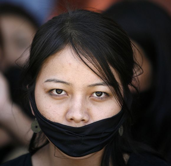 A Manipuri student participates in a protest
