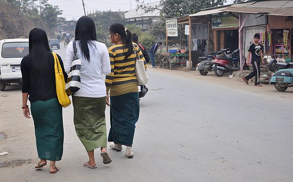 Young girls going for classes wear the phanek, the Manipuri sarong. Following bans by various groups, schools and colleges made it mandatory for girls to wear the phanek