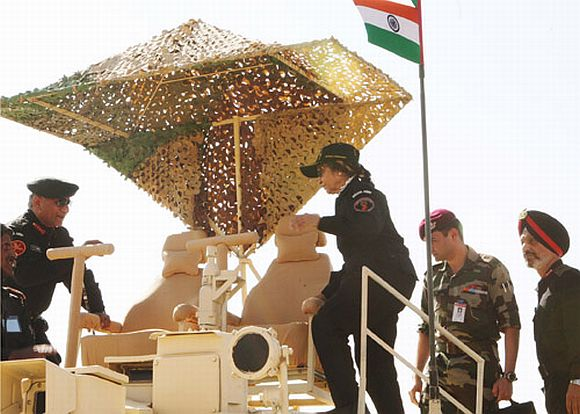 President Patil climbing on board the T-90 Tank of the Indian Army during Exercise Sudarshan Shakti near Jodhpur on December 5