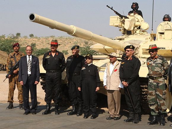 Patil stands before the T-90 tank that she rode during the Strike Corps Offensive Operation by GOC-in C Southern Command and GOC 21 Corps, at Pachpadra, Rajasthan on December 05. Defence Minister A K Antony is also seen