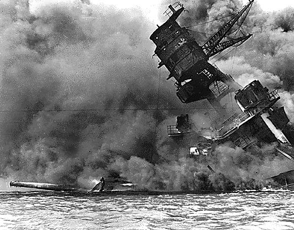 A view of the USS ARIZONA burning after the Japanese attack on Pearl Harbour in Hawaii December 7, 1941