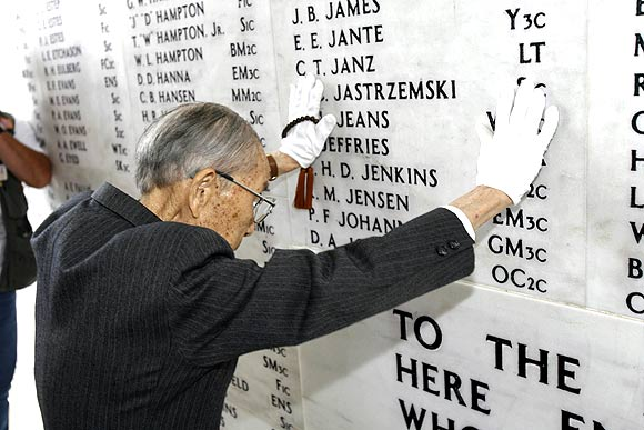 Zenji Abe, a Japanese pilot who attacked Pearl Harbor on December 7 1941, pays respects at the memorial wall at the USS Arizona