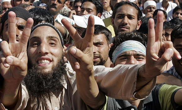 Kashmiri protesters gesture during a sit-in demonstration in Srinagar