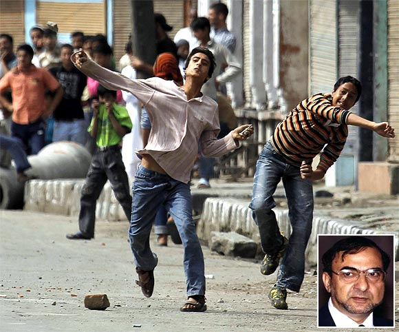 Kashmiri protesters throw stones towards policemen during an agitation. Inset: Syed Ghulam Nabi Fai