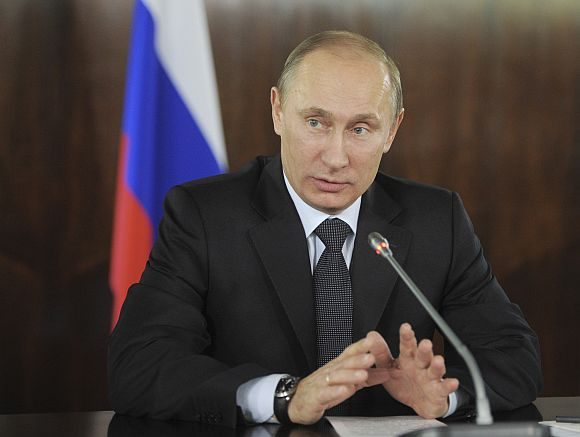 Russian PM Putin gestures during a meeting with organisers of the All-Russian People's Front in Moscow on Thursday