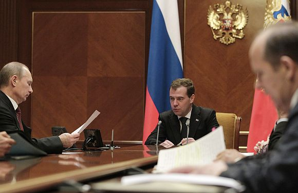 Russia's President Medvedev speaks with PM Putin during a meeting of the security council at the presidential residence at Gorki on Wednesday
