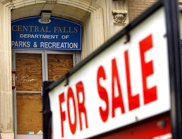A 'For Sale' sign is seen outside the boarded up entrance to the Central Falls Department of Parks and Recreation in Central Falls, Rhode Island August 1.  Central Falls, one of a handful of US cities and counties facing fiscal collapse in the wake of the economic recession, filed for a rare Chapter 9 bankruptcy