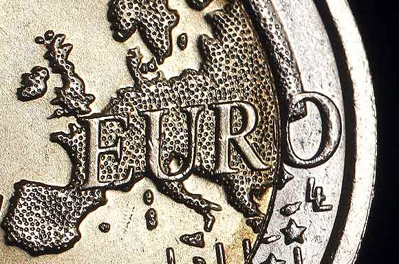 The map of Europe is featured on the face of a two Euro coin seen in this photo illustration taken in Rome, December 3. Standard & Poor's has warned it may carry out an unprecedented mass downgrade of euro zone countries, including Germany and France, if EU leaders fail to deliver a convincing agreement on how to solve the region's debt crisis