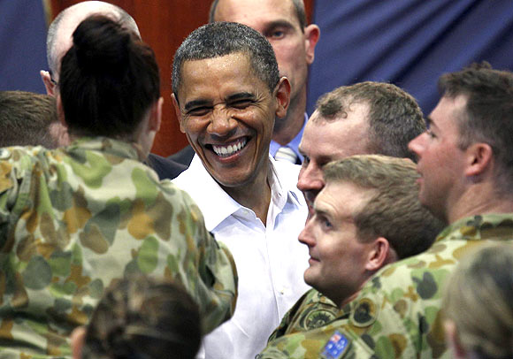 US President Barack Obama shakes hands with Australian troops while at the RAAF Base in Darwin. From next year, US troops will operate out of of Darwin to respond quickly to crisis in Southeast Asia, if any