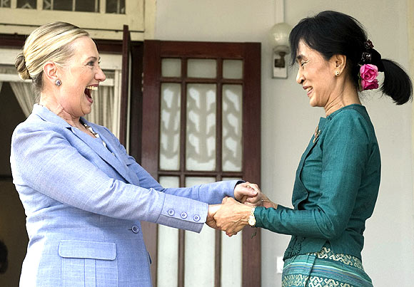 Pro-democracy leader Aung San Suu Kyi and US Secretary of State Hillary Clinton speak after meeting at Suu Kyi's residence in Yangon on December 2. Suu Kyi welcomed on Friday US engagement with Myanmar, saying she hoped it would set her long-isolated country on the road to democracy
