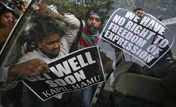 Activists in New Delhi protest against Kapil Sibal's remarks