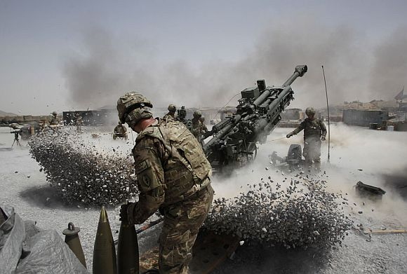 US Army soldiers from the 2nd Platoon, B battery 2-8 field artillery, fire a howitzer artillery piece at Seprwan Ghar forward fire base in Panjwai district, Kandahar province southern Afghanistan, June 12, 2011