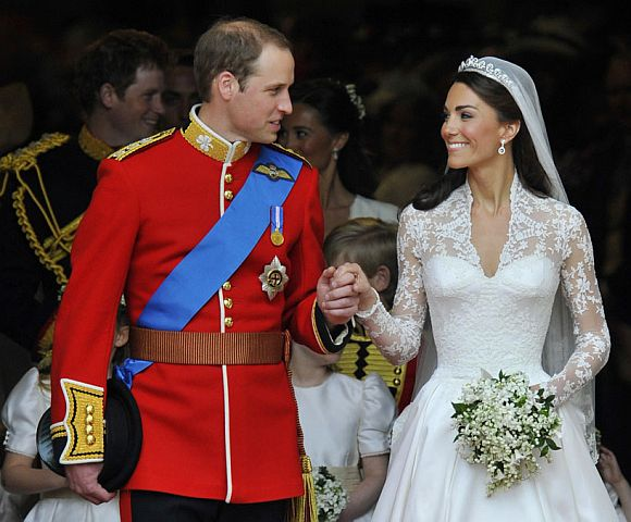Britain's Prince William (L) and Catherine, Duchess of Cambridge, look at one another after their wedding ceremony in Westminster Abbey, in central London April 29, 2011
