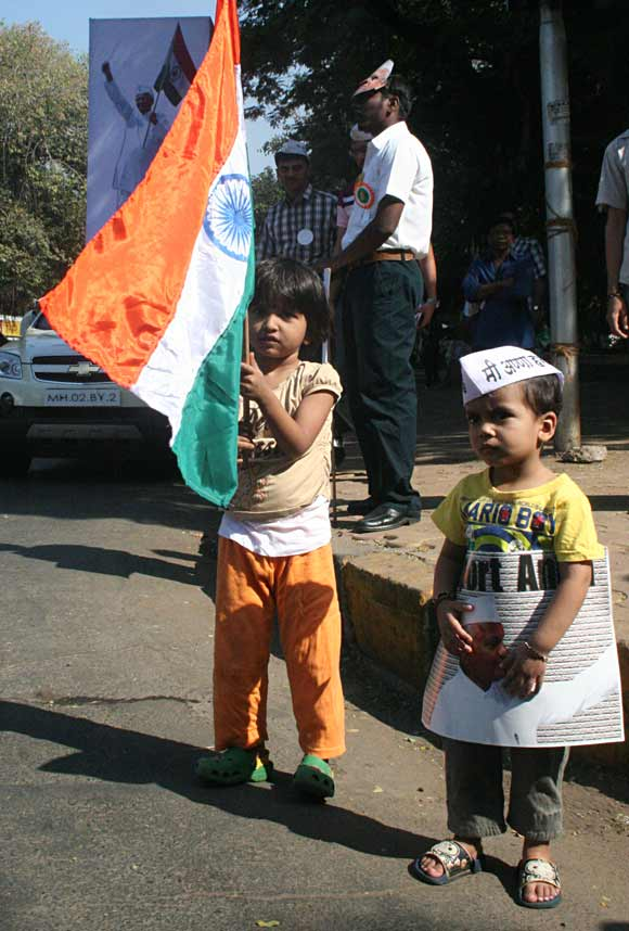 A girl holding the national flag and a boy sporting the Gandhian cap in Mumbai