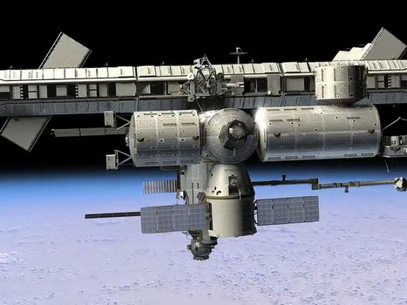 An artist impression of the Dragon berthed at International Space Station
