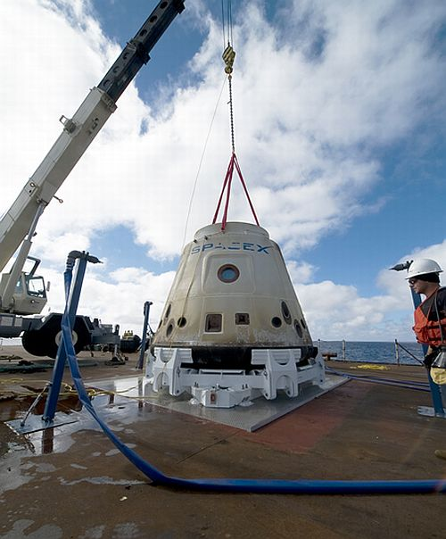 During test: The SpaceX crew brings the Dragon back to the barge where the crane lifted it from the water