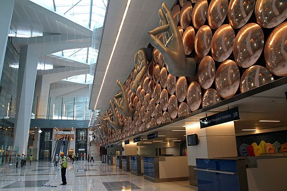 Labourers work inside the newly constructed Terminal 3 at Indira Gandhi International Airport in New Delhi
