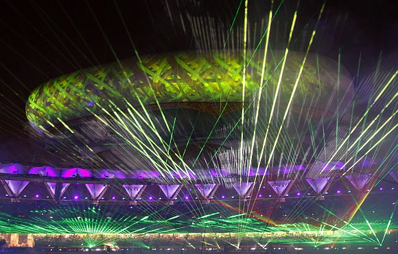 The Jawaharlal Nehru stadium is illuminated by lasers during the Commonwealth Games closing ceremony in New Delhi