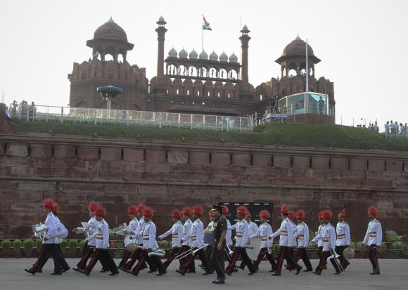 Soldiers march past the Red Fort during a rehearsal for India's Independence Day celebrations in Delhi.