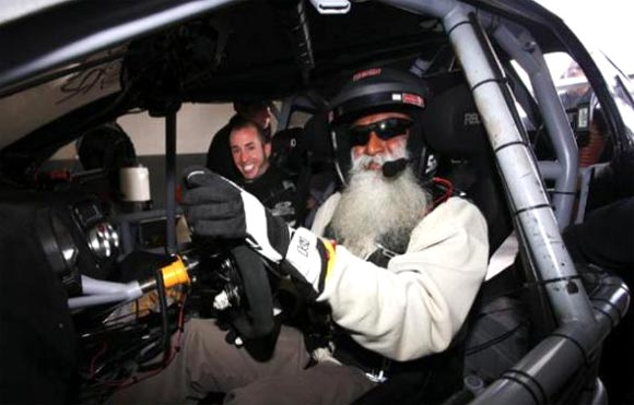 Sadhguru Jaggi Vasudev with racing car driver Chris Rado