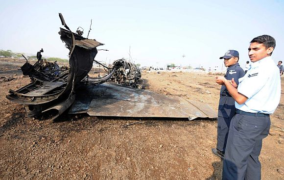 IAF personnel inspect the site near Pune where the Sukhoi-30 jet crashed