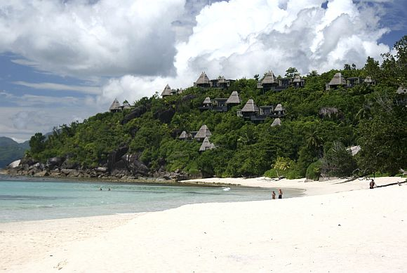 A general view shows tourists on the sandy beaches outside the Seychelles capital Victoria