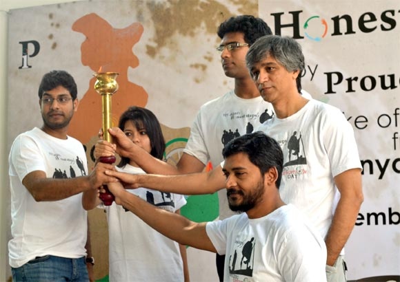 Members of 'Proud Indians' with the 'Flame of Honesty' that they will be carrying during their walkathon.