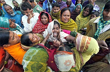 Family members mourn for their relatives outside a hospital at Diamond Harbour