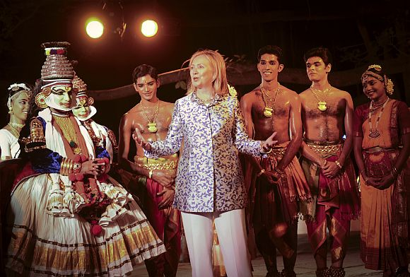 US Secretary of State Hillary Clinton greets Indian dance performers during her visit to Chennai