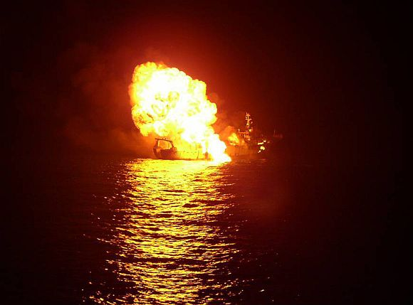A handout photo shows a pirate vessel after it was blown up by an Indian Navy warship in the Gulf of Aden