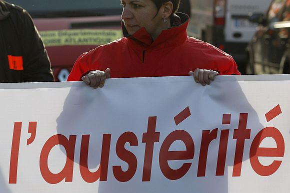 Private and public sector workers take part in a demonstration to protest against austerity measures in Nantes, France