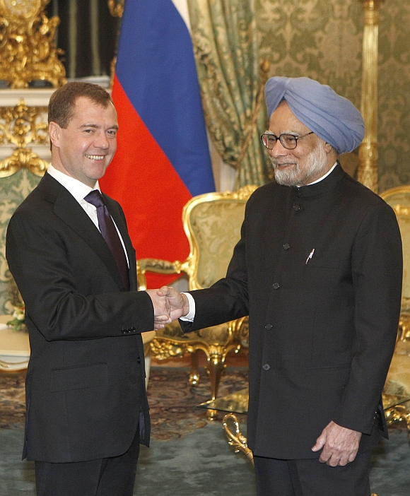 Russian President Dmitry Medvedev shakes hands with Prime Minister Manmohan Singh during their meeting in Moscow's Kremlin