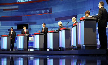 Republican presidential candidates (L-R), former Pennsylvania Senator Rick Santorum, Texas Governor Rick Perry, former Massachusetts Governor Mitt Romney, former House Speaker Newt Gingrich, Representative Ron Paul (R-TX), Representative Michele Bachmann (R-MN), and former Utah Governor Jon Huntsman participate in a Republican presidential debate in Sioux City, Iowa, December 15, 2011