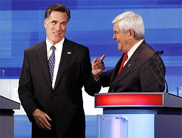 Former Massachusetts Governor Mitt Romney (L) and former US Speaker of the House Newt Gingrich (R-GA) at the Iowa debate