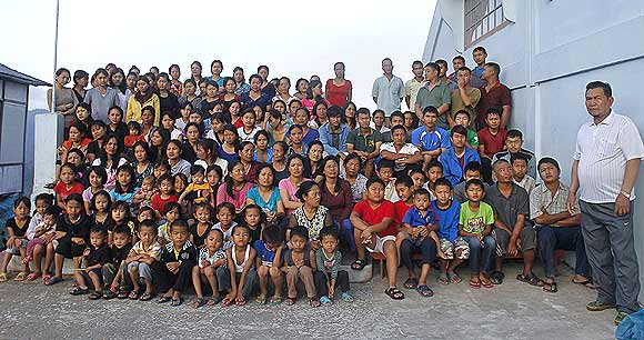 Family members of Ziona (right) pose for group photograph outside their residence in Baktawng village, Mizoram