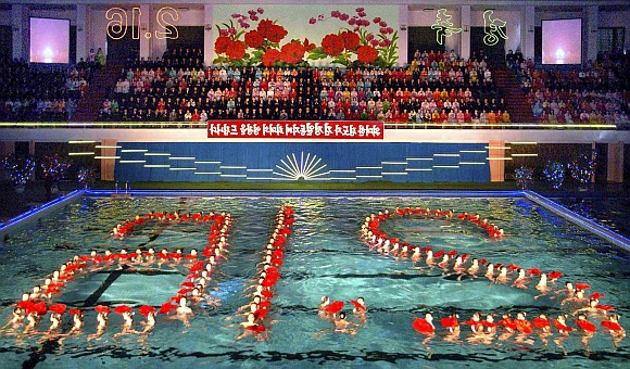 North Korean synchronised swimmers perform to celebrate Kim Jong-il's birthday, in a swimming pool of the Changgwang Health Complex in Pyongyang