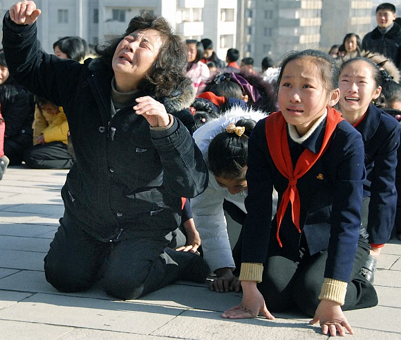 Pyongyang residents react as they mourn over the death of Kim Jong-il