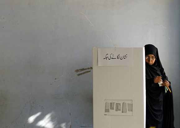 File image of a woman casting her vote during the 2008 general polls in Pakistan