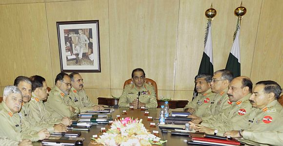 File photo shows Kayani chairing a meeting of top generals